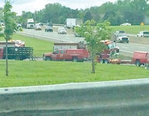 In this view from the Corunna Road bridge over I-75, emergency crews still were cleaning up several hours after a semi-truck rolled over on the southbound entry ramp to I-75, restricting traffic to one lane. Police also roped off the southbound entrance to the freeway during the clean-up.