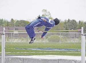 Carman-Ainsworth's Jacoby Blount clears the bar during a meet with Lapeer on May 2.