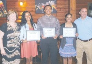 Deborah Davis, High School Principal & Rotarian with student honorees (l-r) Alicia Brown Jakori Miller and Kendall Bragg, and teacher Jay Witham.