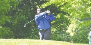 Carman-Ainsworth's Tyson Fields watches his tee shot fly toward the green at the regional tournament last Thursday at Metamora Golf and Country Club.