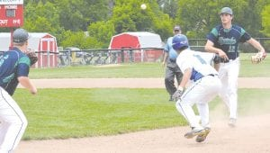 Carman-Ainsworth's Christian Buchanon gets caught in a pickle against Heritage during Saturday's district tournament.