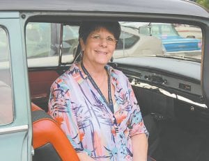 Nancy Earls, of Monroe, posed for a photo before taking off from Flint, sitting in her 1956 Buick Special, which initially belonged to her grandfather. The car, which was featured on this year's Promo Tour T-shirt, has retained almost all of its original parts.