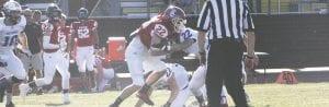 Swartz Creek's Adam Frye runs through defenders during Saturday's Flint-area All-Star Game.