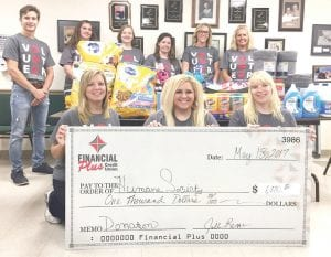 Financial Plus staff with the check they donated to the Genesee County Humane Society