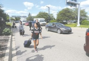 To avoid the ensuing traffic backup when the airport reopened, several passengers walked in with their luggage.