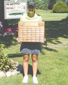 Kerri Parks of Flushing poses for a photo after shooting a 75 to win the Henrickson Award at Atlas Valley Country Club.