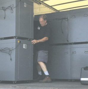 Old voting machines were loaded on a truck by Bob Heyl, a contract driver for Hart Intercivic, suppliers of the new equipment for Genesee County voting machines.