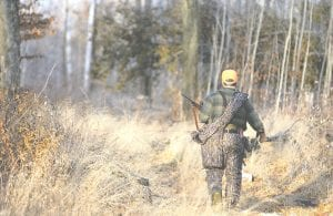 A Michigan hunter takes to the field. Hunters and others in Michigan will continue to play a vital role in battling bovine tuberculosis in the state's deer populations.