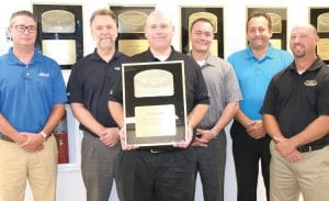 The management staff at Szott Ford in Holly pose with their six President's Awards, presented to the dealership for outstanding customer service. From left, Sales Manager Chris Boan, Parts Manager Dave Pado, General Manager Steve Gabbara, Finance Manager Anthony Ketchum, Sales Manager Darren Miller, and Service Manager John McLellan.