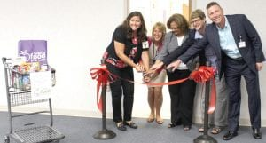 Left to right: Alisa Craig, Hurley Administrator of Wellness & Population Health, Susanne Gunsorek, Food Pharmacy Coordinator and Dietician, Wanda Harden, Community Foundation of Greater Flint Trustee, Sue Peters is the VP of Community Impact at Community Foundation of Greater Flint and Mike Burnett, Hurley's Chief Strategy Officer pose for the official ribbon cutting of the new Hurley Food Pharmacy.