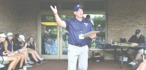 Lapeer coach and host of Friday's Tune-Up, Steve Carlson, announces medalists following the tournament.