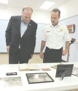 Dan Kildee spent some time at fire station one looking through old log books and photos that preserve his grandfather's legacy as the township's first fire chief.