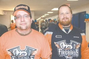 Chip Whitfield and his friend Chris Ilbrink, both of Flint, attended the Firebirds' Fan Fest at Dort Federal Credit Union Event Center.