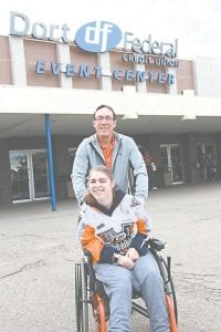 Craig and Lindsey Freund, of Flint, arrived at the Dort Federal Credit Union Event Center on Wednesday evening for the third annual Firebirds' Fan Fest, allowing season ticket holders to pick their seats, and offering visitors food, activities, and the opportunity to meet the Firebirds.