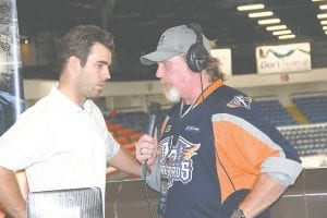Firebirds coach Ryan Oulahen stops for an interview with 103.9 The Fox's Roy Moore during last week's third annual Firebirds' Fan Fest, held at Dort Federal Credit Union Event Center Wednesday evening.