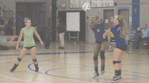 Carman-Ainsworth's Diamond Lester (6) and Morgan Sherrer attempt to set a ball on Tuesday night at Flint Powers.