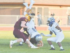 Carman-Ainsworth's Dustin Fletcher dives for a first down during last week's game at Davison.