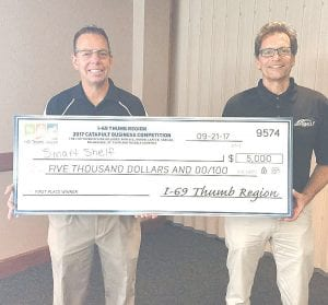 Accepting their check were first-place winners Dan and Ed Cass of Smart Shelf in St. Clair.
