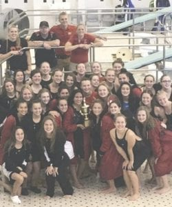 The Grand Blanc swim and dive team poses with its trophy after the County Championship meet at Fenton Saturday.