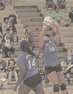 Carman-Ainsworth's Amaya Campbell )14) watches as 16 (not listed on roster), prepares to set the ball on September 12.