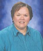 Ronda Miller, high school athletics office secretary, is the parade Grand Marshal.