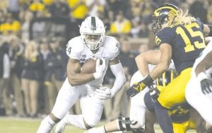 Carman-Ainsworth grad and Michigan State senior running back carries the rock against Michigan at the Big House on Oct. 7.