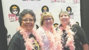 Marsha Schmit (center), Hurley Breast Health Nurse Navigator, shares a laugh with two of her program participants; Gailene Adams (left) and Betty Echlin (right). They were all smiles and decked out in their best Pink Palooza garb.