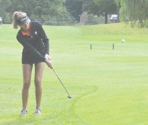 Grand Blanc's Cameryn Cass chips onto the green during the Lapeer Tune-Up on August 18.