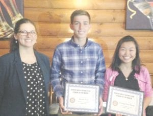 Teacher Krystal Roos with students of the month Jacob Yost and Evangelina Dang.