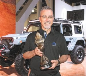 """Pietro Gorlier, Head of Parts and Service (Mopar) - FCA, with the """"Hottest 4x4-SUV"""" award, claimed by the Jeep Wrangler for the eighth consecutive year at the Specialty Equipment Market Association (SEMA) Show in Las Vegas."""