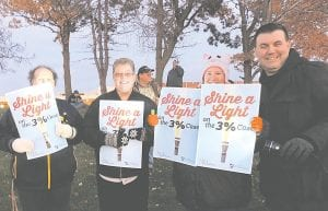 About 125 members from MEA Region 10 in Genesee and Lapeer counties attended a flashlight vigil last week to bring public awareness to their ongoing lawsuit against the State of Michigan.