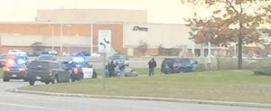 Police cars blocked the back entrance to Genesee Valley Center mall during the apprehension of a fugitive from Indiana.