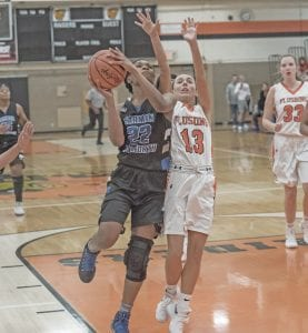 Carman-Ainsworth's Bless Calhoun in Tuesday season opener against Flushing.