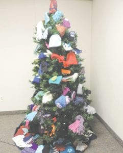 The Christmas Tree at the township hall is decorated with gifts that will be donated to help keep children warm.
