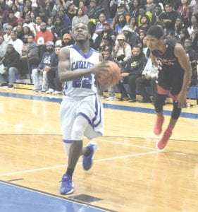 The Cavs' O'mari Duncan drives to the hole in last Tuesday's win over Grand Blanc.
