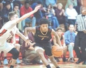 Boys' high school basketball will start one week earlier than girls' in 2018. Here, Davison and Swartz Creek went head-to-head on Dec. 5.