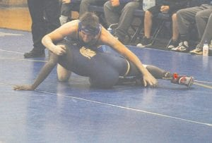 A change to the rules this season allows for wrestlers in the down position to continue competing as long as the supporting point(s) of either wrestler are in-bounds.