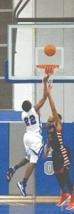 The Cavs' O'Mari Duncan lays the ball over a Grand Blanc defender on Dec. 5.