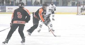 SCF's Seth Crompton skates the puck past a Lapeer defender at the Polar Palace on Nov. 29.