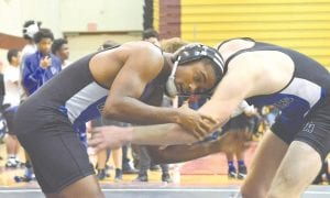 Carman-Ainsworth's My'Kah Lewis, left, wrestles teammate Nathan Delong at the County Meet on Dec. 16 at Davison High.