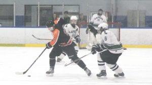 SCF's Kam Houle skates the puck through the neutral zone against Lapeer on Nov. 29.