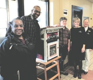 From left, Valorie Horton, Board President for The Friends of Berston, Bryant Nolden, Executive Director, Friends of Berston, Nigel Tate, student Genesee Career Institute Construction Trades, Nicole Sterling, Community Relations Coordinator Dort Federal Credit Union, and Vicki Hawkins, President and CEO Dort Federal Credit Union.