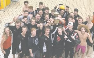 Grand Blanc's boys' swim and dive team poses for a photo with their championship trophy following last Saturday's Genesee County Meet victory.