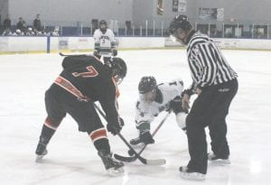 SCF's Mitchell Carlson takes the faceoff against Lapeer at the Polar Palace.