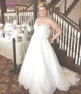 Dana Jewell modeled a wedding dress by Expressions in Silk at Sunday's Wedding Marketplace.