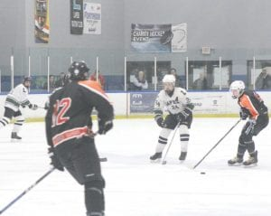 SCF's Preston Weisberg controls the puck during a game against Lapeer at the Polar Palace.