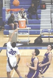 Carman-Ainsworth's Jamarreyon Houston goes up for a lay-up against Bay City Central on Jan. 16.