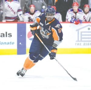 Flint defenseman Jalen Smereck skates along the blue line against the Kitchener Rangers.