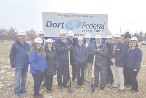 From left, Michael Mantei, Building Official, Vienna Township; Laura Cipielewski, Director of Marketing, Dort Federal Credit Union; Jeff Ferweda, Chairman of the Planning Commission, Vienna Township; Diane Piercy, Director, Dort Federal Credit Union; Douglas Kidd, Chairman of the Board, Dort Federal Credit Union; Ralph LaMacchia, President, LaMacchia Group; Vicki Hawkins, President & CEO, Dort Federal Credit Union; Jeremy Zager, CFO, Dort Federal Credit Union; Joseph A. Rizk, Supervisor, Vienna Township; Janet Mowl, Administrator of the Business Development Authority, Vienna Township; Dan Gatfiield, Director of Operations, Dort Federal Credit Union; Harry Awdish, Vice Chairman of the Board, Dort Federal Credit Union; Deana Turcott, Director of Human Resources, Dort Federal Credit Union.