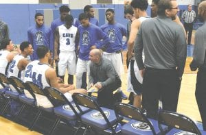 Carman-Ainsworth coach Jay Witham addresses his team during a timeout against Bay City Central on Jan. 16.